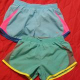 Nike Bottoms | 2 Pair Of Girls Nike Shorts Size Small | Color: Blue/Green | Size: Sg