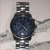Michael Kors Other | Michael Kors Blue Face Silver Watch | Color: Silver | Size: Os
