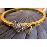 Coach Jewelry | Coach Pave Bow Bangle - Nwot | Color: Gold/White | Size: Os