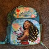 Disney Accessories   Moana Backpack   Color: Blue   Size: School Backpack