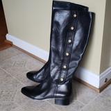 Nine West Shoes | Ninewest Black Knee High Leather Emblem Boots Nwt | Color: Black | Size: 9