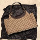 Gucci Bags   Gucci Gg Logo Signature Hobo Bag   Color: Brown   Size: 11h X 15w X 4base, Strap Drop 9