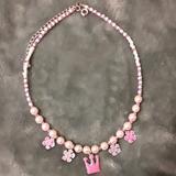 Disney Other | Disney Princess Necklace, Nwot | Color: Pink/White | Size: Osbb