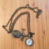 Anthropologie Jewelry   Anthropologie Bicycle Clock Necklace   Color: Gold/Silver   Size: Os