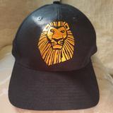 Disney Accessories | Disney Presents The Lion King Hat Broadway | Color: Black/Gold | Size: Os