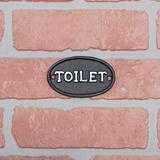 Gracie Oaks Helen Cast Iron Toilet Restroom Door Sign Metal in Black, Size 2.0 H x 26.5 W x 1.0 D in   Wayfair 0CB0E7790A8E429E8D0DD1D256DCFE52