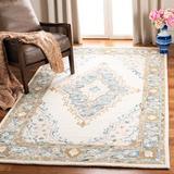 World Menagerie Bridgham Oriental Handmade Tufted Wool Ivory/Area Rug Wool in Blue, Size 96.0 H x 60.0 W x 0.59 D in   Wayfair