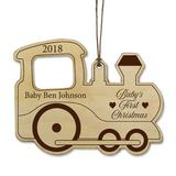 The Holiday Aisle® Baby's First Christmas Train Baby Holiday Shaped Ornament Wood in Brown, Size 3.5 H x 4.5 W x 0.13 D in   Wayfair