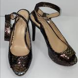Jessica Simpson Shoes | Jessica Simpson Snake Print High Heel Pumps | Color: Brown/Gold | Size: 8