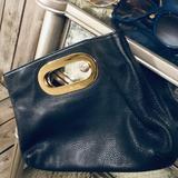 Michael Kors Bags   Michael Kors Berkley Leather Clutch   Color: Black/Gold   Size: Michael Kors