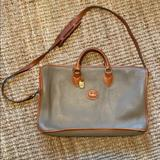 Dooney & Bourke Bags   Dooney And Bourke Brief Cast   Color: Tan   Size: Os