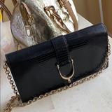 Gucci Bags   Gucci Black Stirrup Leather Clutch   Color: Black   Size: Os