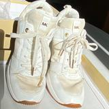 Michael Kors Shoes   Michael Kors Georgie White Sneakers 36.5   Color: Gold/White   Size: 6.5