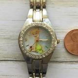 Disney Accessories | Disney Tinkerbell Silver Tone Watch Tnk557 | Color: Silver/White | Size: The Band Measures Approx 7.5