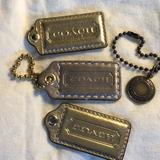 Coach Accessories | Coach Bronze Hang Tags | Color: Gold/Silver | Size: Os