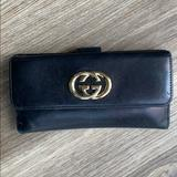 Gucci Bags | Authentic Gucci Black Leather Bi-Fold Long Wallet | Color: Black/Gold | Size: Os