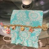 Lilly Pulitzer Jewelry | Lilly Charm Bracelet | Color: Gold | Size: Os
