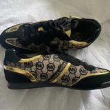 Michael Kors Shoes | Michael Kors Black And Gold Sneakers | Color: Black/Gold | Size: 8.5