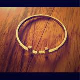 Anthropologie Jewelry | Jewelry Gold Tone Bangle Bracelet W Crosses | Color: Gold | Size: Os