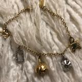 Coach Jewelry | Coach Gold Charm Bracelet | Color: Gold/Silver | Size: Os