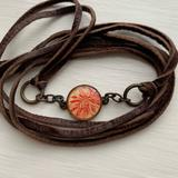 Urban Outfitters Jewelry | Leather Wrap Bracelet With Charm | Color: Brown/Pink | Size: Os