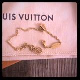 Louis Vuitton Jewelry | Lv & Me Letter S Bracelet | Color: Gold | Size: Os