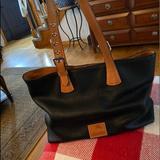 Dooney & Bourke Bags   Black And Beige Tote Dooney & Bourke Bag.   Color: Black   Size: L- 14 H- 10.5 Shoulder Drop 10.5- Adjustable