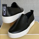 Michael Kors Shoes | Michael Kors Teddy Slip On Lasered Nappa Pu Black | Color: Black/White | Size: Various
