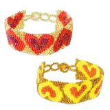 Beaded wristband bracelets, 'Hearts in a Row' (pair)