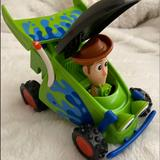 Disney Toys   Toy Story Race Car & Woody Pop-Up Figure   Color: Blue/Green   Size: Osbb