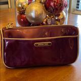 Michael Kors Bags | Michael Kors Cosmetic Bag | Color: Gold/Tan | Size: 7 12 Across 4 Tall 2 12 Base