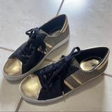 Michael Kors Shoes | Michael Kors Black And Gold Sneakers | Color: Black/Gold | Size: 7