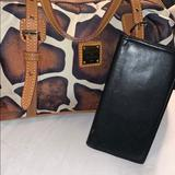 Dooney & Bourke Bags | Dooney & Burke Cow Print Barrel Shaped Satchel | Color: Brown | Size: Os