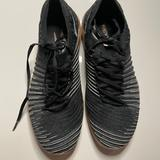 Nike Shoes | Nike Black And Gold Sneakers- Size 6 | Color: Black/Gold | Size: 6