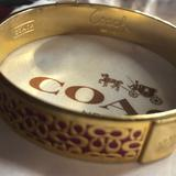 Coach Jewelry | Gold Coach Bangle Bracelet | Color: Gold/Pink | Size: Os