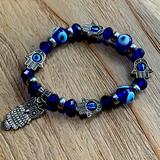 Anthropologie Jewelry | Evil Eye & Hamsa Bracelet With An Owl Charm | Color: Blue/Silver | Size: Os