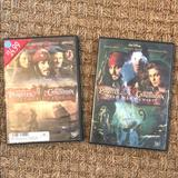 Disney Other | 2 Pirates Of The Caribbean Disney Dvds | Color: Brown | Size: 2 Dvds