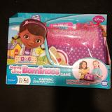 Disney Toys | Nwt! Doc Mc Stuffins Sharing Is Caring Dominoes | Color: Pink/Purple | Size: Osg
