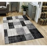 Wrought Studio™ Mirac Checkered Tufted Indoor/Outdoor Area Rug Polypropylene in Black/Gray, Size 84.0 H x 24.0 W x 0.02 D in   Wayfair