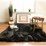 Etta Avenue™ Dominick Handmade Shag Faux Sheepskin Black Area Rug Sheepskin/Faux Fur in Black/Brown, Size 48.0 W x 2.5 D in | Wayfair