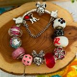 Disney Jewelry | Minnie Charms On Minnie Closure Bangle Bracelet | Color: Pink/Silver | Size: 7 Inches