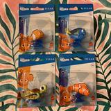Disney Toys | 4 Piece Disney Pixar Finding Nemo Mini Figures Nwt | Color: Blue/Orange | Size: 4 Mini Figures