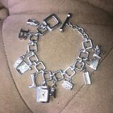 Burberry Jewelry   Burberry Watch Charm Bracelet   Color: Silver   Size: 7inchs