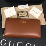 Gucci Bags   Gucci Unisex Zip Around Wallet Leather   Color: Brown   Size: Os