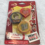 Disney Party Supplies   New High School Musical Foil Erasers Pencil Topper   Color: Orange/Red   Size: Os