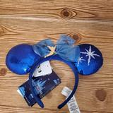 Disney Accessories   Disney Peter Pan Minnie Attractions Ears   Color: Blue   Size: Os