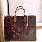 Louis Vuitton Bags   Louis Vuitton Women'S Bag Double-Sided Handbag   Color: Brown/Tan   Size: Os