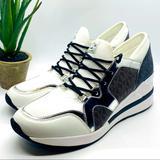 Michael Kors Shoes | Michael Kors Signature Logo Liv Trainer Sneakers | Color: Silver/White | Size: 10