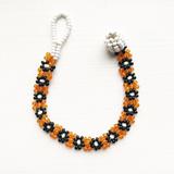 Orange & black beaded Girls' flower bracelet