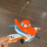 Disney Toys | Disney Pixar Plane Dusty With Spinning Propeller | Color: Orange/White | Size: Osb